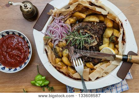 Kleftiko - slowly cooked lamb with vegetables and feta cheese. Traditional Greek dish.