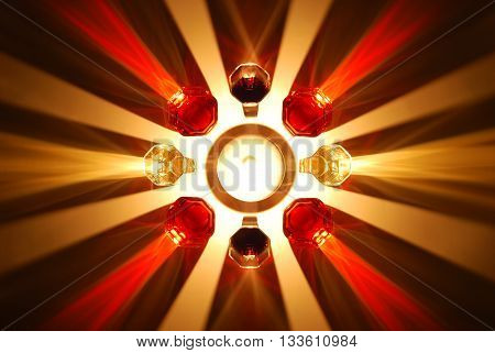 coloured shadows of wine glass illuminated by a candle