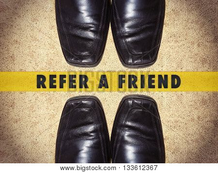 Black men shoes with words refer a friend