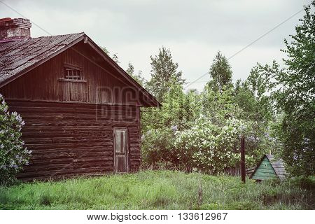 Old wooden house and doghouse. Retro photo effect.