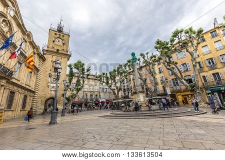People Enjoy Sitting At The Central Place In Aix En Provence At Town Hall
