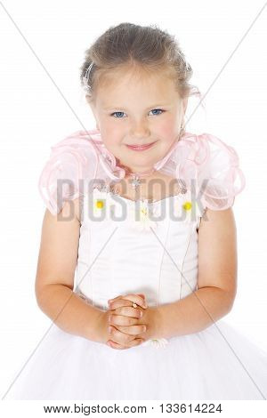 young blue eyes child with light hair wears white dress and holds hands like lock Half-lenght portrait on white background, isolated