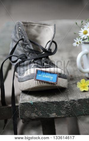 Wedding inscription and one shoe on vintage old wooden table