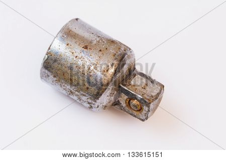 Old rusty dirty socket adapter on white