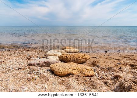Stones on the beach, sunny summer day.