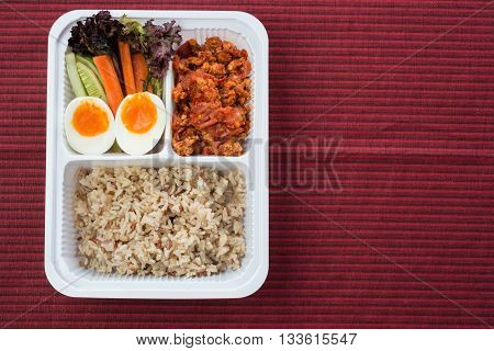 Food series : Spicy chicken and tomato dip, served with brown rice and fresh vegetable, Thai foods, northern style