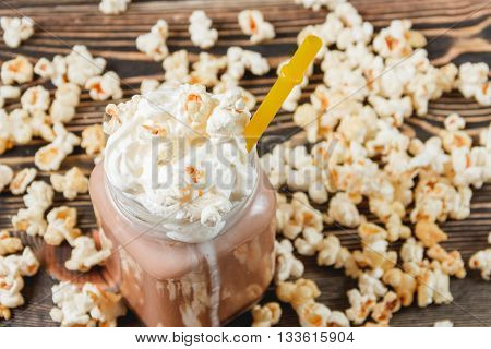 Fresh Popcorn Cocoa on Wodden Background Unhealthy Food Concept