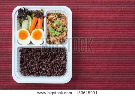 Food series : Sour and spicy tuna salad. Served with brown rice and fresh vegetable, Thai foods