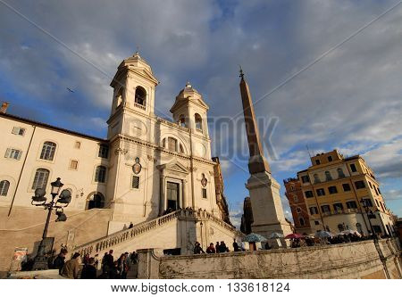 ROME, ITALY - NOVEMBER 24: Tourists visiting Trinita dei Monti church at sunset, at the top of the famous Spanish Steps, in the historic center of Rome NOVEMBER 24, 2010 in Rome, Italy