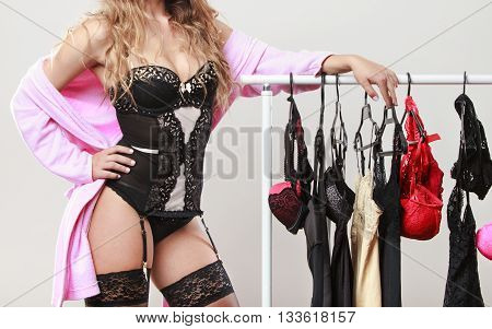 Sexy Woman Buyer In Shop With Lingerie.