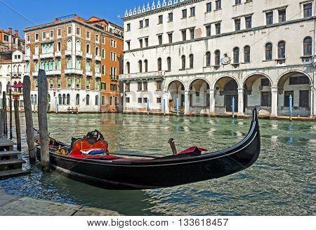 Venice, Italy - September 7, 2012: Gondola, famous boat of Venice on the one of its Canals