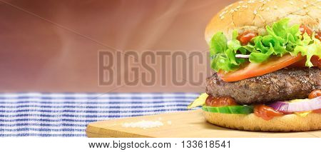 Hamburger homemade authentic hamburger with fresh vegetables - horizontal copy space layout