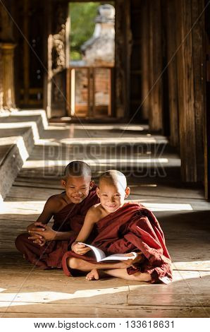 Group Of Burmese Novices, Young Monks, Reading Book