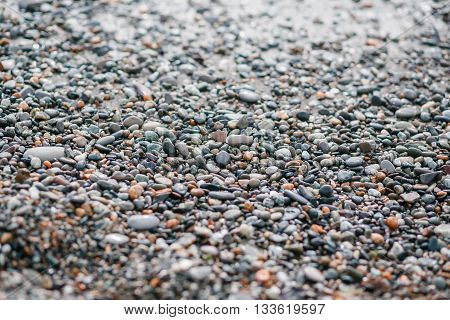 Nature background from gray sea pebbles. morning