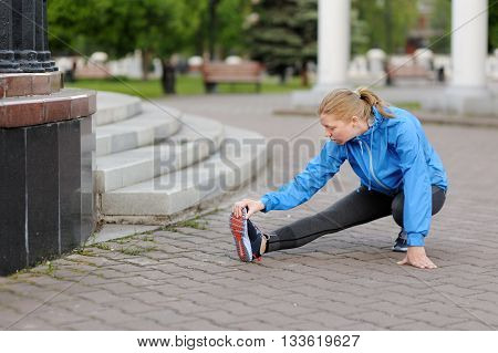 Exercise Woman Stretching Hamstring Leg Muscles Duing Outdoor Running Workout.