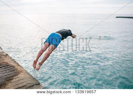 Young man jumping into water. save life. man drowns