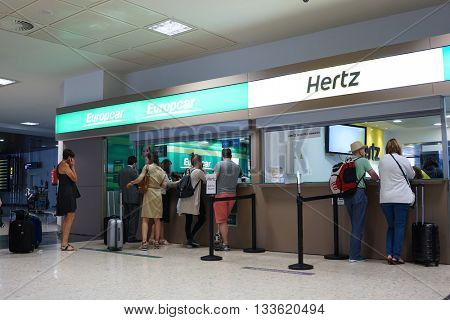 VALENCIA, SPAIN - JUNE 9, 2016: Rental car counter at the Valencia, Spain Airport. Approximately 4.98 million passengers passed through the Valencia airport in 2015.