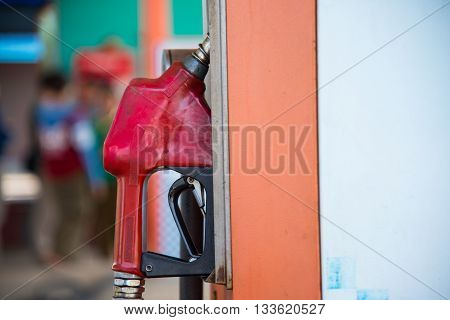 Old Red Fuel Nozzle On Gas Station For Refueling The Car