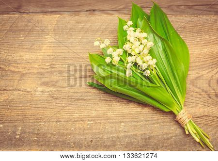 Bouquet Of Lilies Of The Valley On The Wooden Background. Spring Background