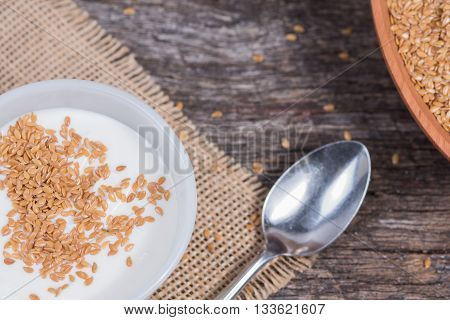 Flag seed in yogurt with spoon to the side