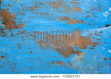 texture/background - blue wooden board with chipping paint and scratches