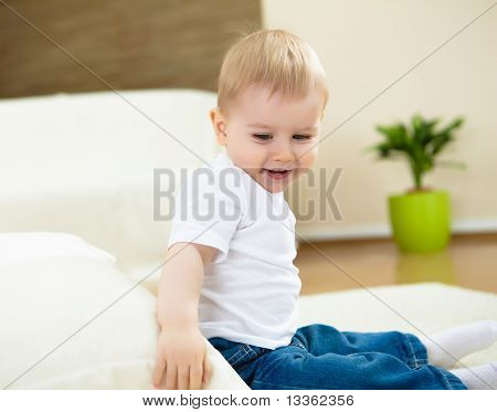 little boy playing on the floor at home