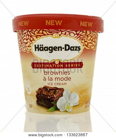 Winneconne WI - 7 June 2016: Container of Hageen Dazs ice cream in Destination series brownies a la mode flavor on an isolated background