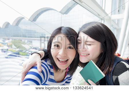 Happy group travel women hold passport and take a selfie. shot in hong kong asian