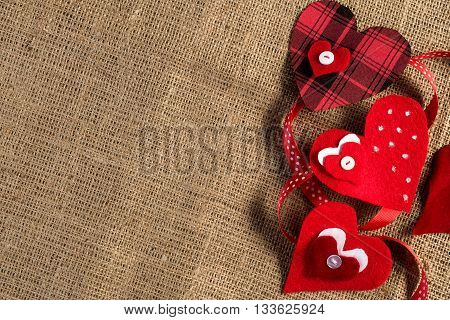 Handmade love hearts on brown clothing. Place your text