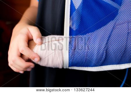 blur kid holding his broken arm for background