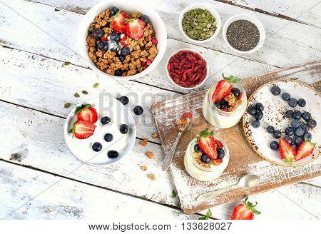 Yogurt, Muesli, Berries, Goji And Chia Seeds For Healthy Diet Breakfast.