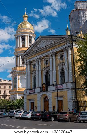 Saint-Petersburg Russia - June 4 2016: The bell tower of the Orthodox Vladimir Cathedral. Cathedral acting located on the Vladimir area. In the foreground - the main facade of the Cathedral.