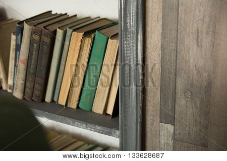 Old Books On A Shelf Close Up Standing