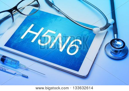 H5N6 word on tablet screen with medical equipment on background