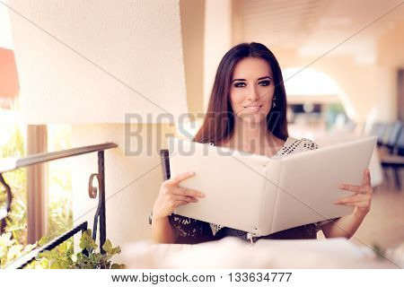 Happy  Woman Choosing from Restaurant Menu Deciding what to Order
