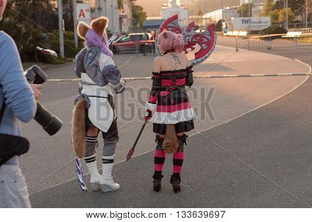 Two Cosplayers Dressed As The Character Elin From Game Tera