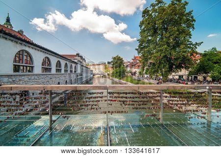 Love padlocks on Butcher's bridge on a bright sunny day, Ljubljana Slovenia