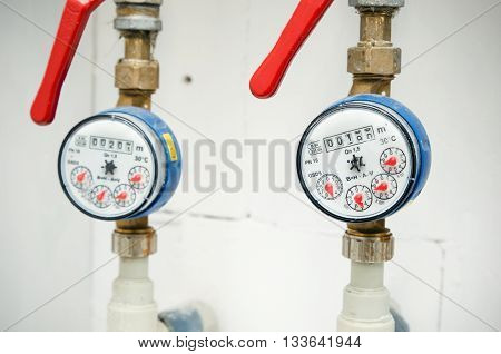 Sanitary equipment. Pair of meters of the water close up