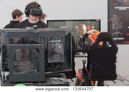 BRNO CZECH REPUBLIC - APRIL 30 2016: Young boy with VR - glasses plays game on PC at Animefest anime convention on April 30 2016 Brno Czech Republic