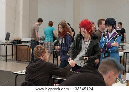 Two Cosplayers Dressed As  Suoh Mikoto And Munakata Reisi