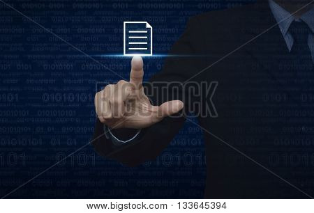 Businessman pressing document icon over computer binary code blue background