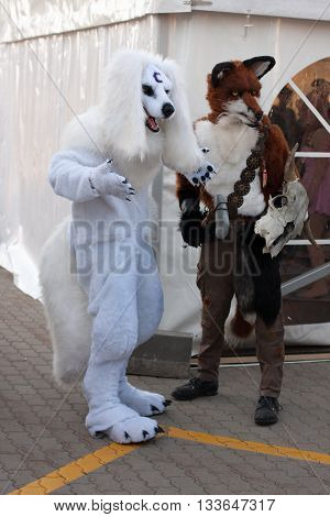Cosplayers Dressed As Characters Wolves Pose   At Animefest