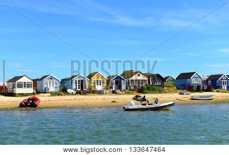 Colored houses on the beach and pontoon