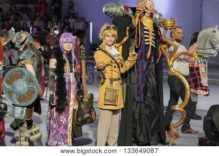 Group Of Cosplayers Pose During Cosplay Contest  At Animefest