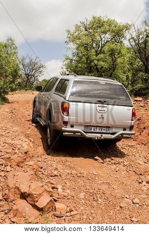 SOUTH AFRICA, HENNOPS - FEBRUARY 6, 2016. Vehicle  Mitsubishi Triton is doing off- road trail.