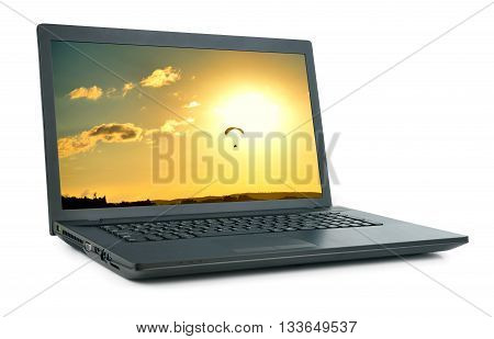 Laptop with picture of moto hang-glide. Isolated on white background