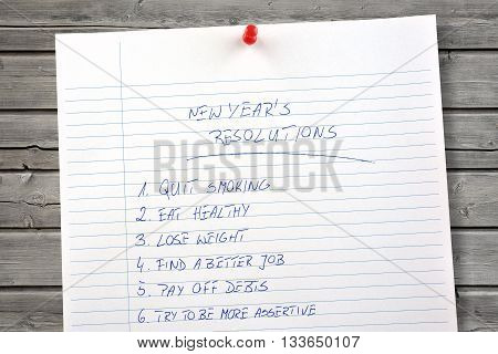 New Year's resolutions list on wooden background