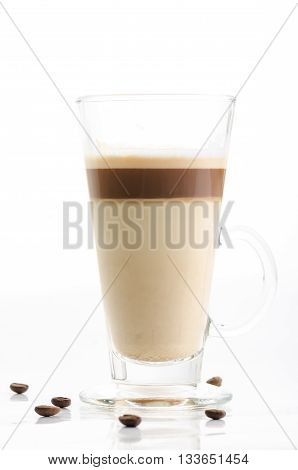 Latte macchiato with coffee beans isolated on white