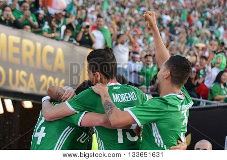 Mexican Soccer Players Celebrating Goal