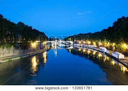 The Tiber river by night in Rome, Italy